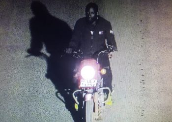 A robber caught on CCTV with a stolen motorcycle