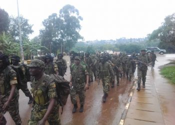 Militants of Uganda Peoples' Defence Forces' Shatterproof Brigade conducting fitness tests in Masaka town on Saturday morning (PHOTO/Courtesy)