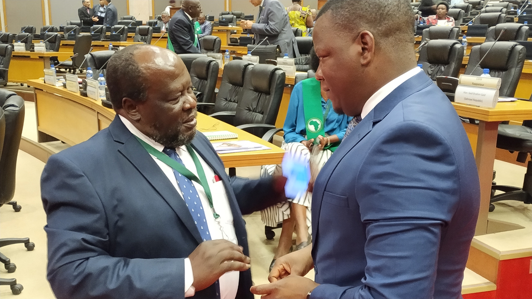 Prof. Ogenga Latigo confers with PAP First Vice President, Stephen Masele, at the opening of the 3rd Ordinary Session of the African Parliament.