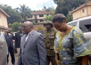 Rwenzururu King Charles Wesley Mumbere and his wife Queen Nyabaghole Agnes Ithungu Asiimwe arrive at the International Crimes Division of the High Court. Photo by Rachel Agaba.
