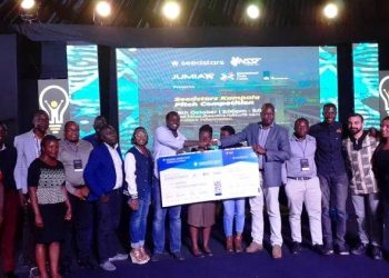 Teheca Limited poses with a dummy cheque shortly after winning the Seedstars Kampala Pitch Competition as part of the Kampala Innovation Week, Kololo Independence Grounds, Kampala Uganda. (PHOTO/PML Daily)