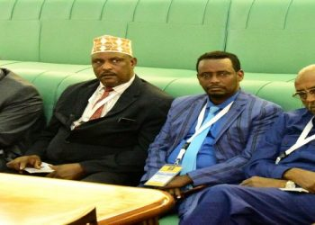 "Somali MPs listen to Deputy Speaker, Jacob Oulanyah's presentation on ""Enforcing parliamentary rules and procedures"" in the Chamber of Parliament on Wednesday"