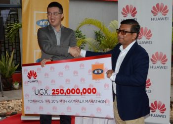 Huawei Managing Director Mr. Liu Jiawei (L) Handing over a cheque of 250,000,000 to MTN Chief Marketing Officer Som Dev for Maternal Health Care (PHOTO/Courtesy).