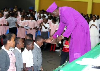The outgoing Archbishop of Church of Uganda, Stanley Ntagali  dedicated primary seven candidates of Kampala Parents' School (KPS) to God ahead of their finals. (PHOTO/PML Daily)