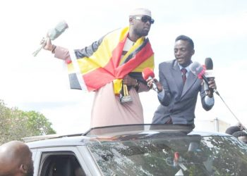Singer Eddy Kenzo accampanied by fellow artiste Aganaga as he  returns home from the US on Tuesday. The singer revealed the forgave