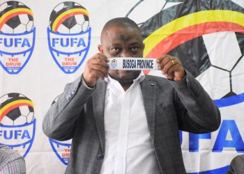 Acting FUFA President Justus Mugisha draws Busoga during the FUFA Drum quarter finals' draws on Monday at Mengo. (PHOTO/FUFA)