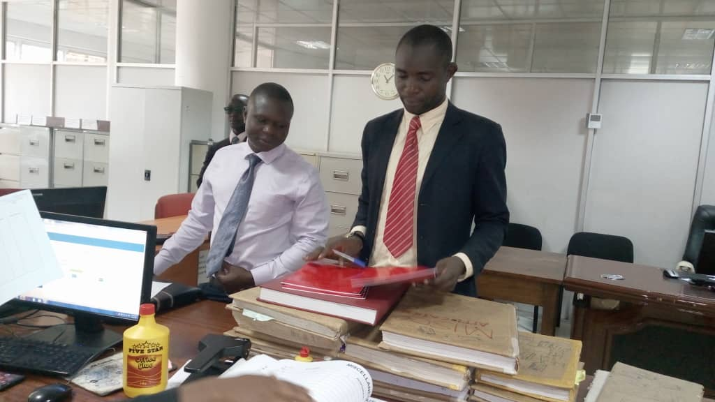 Mr Male Mabirizi in the High Court registry filing his petition. Photo by Rachel Agaba