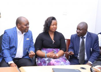 L-R Rwenzururu King Charles Wesley Mumbere and his wife Queen Nyabaghole Agnes Ithungu Asiimwe at the International Crimes Division of the High Court together with one of their ministers . Photo by Rachel Agaba.