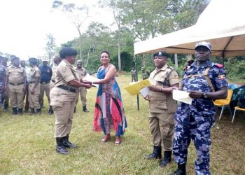 Police officer being awarded a certificate upon completion of traing in Buikwe district (PHOTO/Courtesy)