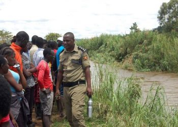 Police and community members gather at the spot where a 22-year-old student of Tororo Technical Institute Mella, Stephen Enapat slid before he drowned in River Malaba on October 19, 2019. PHOTO BY JOSEPH OMOLLO