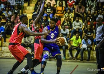 Oilers' Landry Ndikumana (right) holds off two Warriors' players during the FUBA NBL game on Friday at MTN Arena in Lugogo. (PHOTO/ FUBA)
