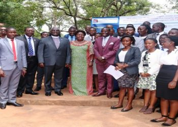 Speaker, Rebecca Kadaga (in green, centre), the Vice Chancellor, John Senyonyi and the University Guild leaders after their swearing in ceremony on Thursday