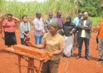 A member of a brick-making women group in Jinja demonstrates to the visiting team from Gambia how they conduct their trade (PHOTO/Courtesy).