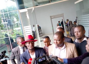 Abtex and Bajo addressing journalists after the hearing of their case. Photo by Rachel Agaba.
