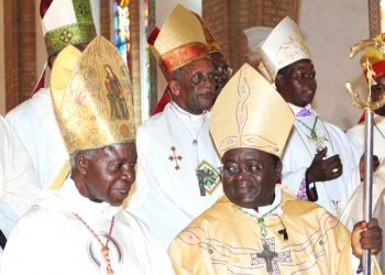 His Eminence Emmanuel Cardinal Wamala (L), Archbishop Cyprian Kizito Lwanga (R) and other Bishops during a mass at Rubaga Cathedral (also known as St. Mary's Catholic Cathedral) in Kampala.