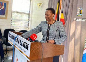 Minister Muloni addressing journalists at Uganda Media Center