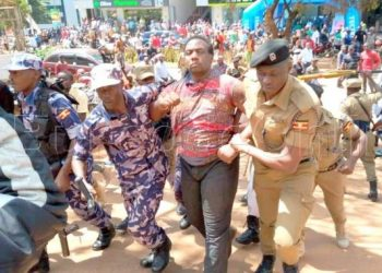Police have detained four men including Amama Mbambazi's former bodyguard Christopher Aine for holding up traffic along Kampala Road saying they were protesting lack of jobs in the country (PHOTO/Courtesy).