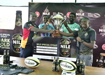 Uganda Rugby and Nile Breweries officials pose with a dummy cheque on Thursday. (PHOTO/URU)