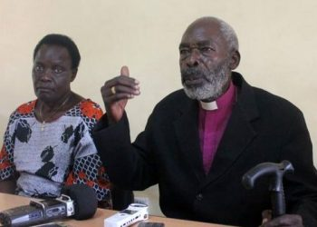 Former Kitgum Diocese Bishop Benjamin Ojwang [Right] and his wife Margarate Ojwang address journalists in Gulu Town in July 2018.