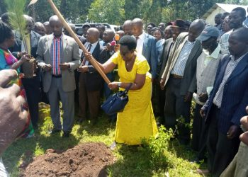 Hon Mary Paula groundbreaks as RDC Kaguta looks on @Nyeibingo Kebisoni