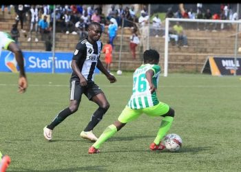 Billy Nkata of Katwe United (R) showing some dribbling skills during their 2-1 loss to Paidha Black Angels. (PHOTO/Courtesy)