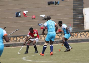 KHC's Dulf Musoke dibbles the ball past his opponents in a recent league game. (PHOTO/Courtesy)