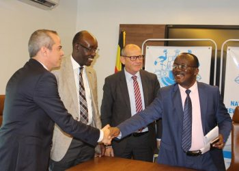 National Water boss Eng Silver Mugisha shake hands with Michael Fest, Director East and Southern Africa HP Gauff (PHOTO/Courtesy).