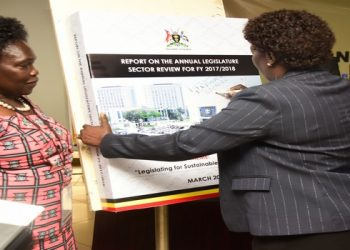 Speaker Rebecca Kadaga (centre) signs the Report of the Annual Legislature Sector Review 2017/2018 at Hotel Africana in Kampala on Thursday 31 October 2019. Left is the Leader of the Opposition in Parliament, Betty Aol Ocan and the Clerk to Parliament, Mrs. Jane Kibirige