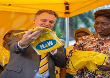 MTN CEO Vanhellepputte(L) hands over kit to the Speaker