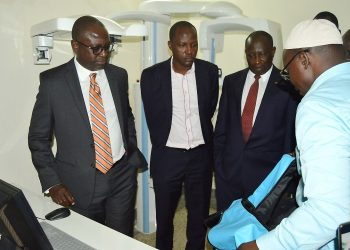 L-R: Dr. Geoffrey Bataringaya, Acting DVCAA-Dr. Christopher Mbazira, Principal CHS-Prof. Charles Ibingira and other officials listen to Member of Staff (Right) demonstrate how the X-Ray Machine (background) donated by the Bataringaya Foundation works on 20th November 2019, Dental Hospital and School, Northcote Road (PHOTO/PML Daily).