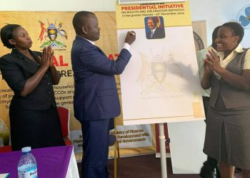 Haruna Kasolo (M), the Minister of State for Microfinance launching the presidential initiative on wealth and job creation in Mukono district on Thursday (PHOTO/Courtesy).