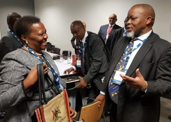 Minister of energy and mineral development Eng Irene Muloni interacts with other diginitaries at the Africa Oil Week in Capetown
