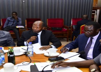 State Minister for Higher Education, Hon. John Chrysostom Muyingo (centre) and MPs during a sitting of the House Committee on Education and Sports on Tuesday
