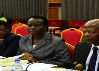 Minister of Education officials led by State Minister for Higher Education, Hon. John Chrysostom Muyingo (right) appearing before the House Committee on Education and Sports on Tuesday