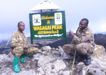 Mr Kyotaite on the right at the Top of Mt Elgon's highest peak_ Wagagai. David Mafabi