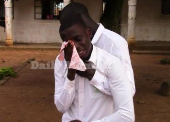 One of the students of Iganga Top Care consoles a colleague weeping after the school administration barred them from entering examination room to sit UACE