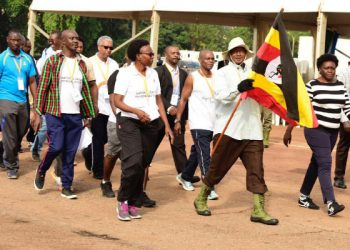 President Yoweri Museveni (with shepherd's crook) leading the walk around Kampala during the National Day of Physical Activity (PHOTO/File).