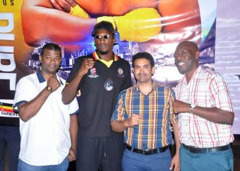 Shafik Kiwanuka (second left) poses with some of his sponsors ahead of the fight. (PHOTO/Courtesy)