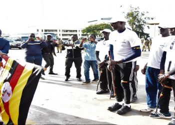 Speaker, Rebecca Kadaga (left) flagging off the St. Katherine Secondary School fundraising walk at Parliament Building on Wednesday (PHOTO/Courtesy).
