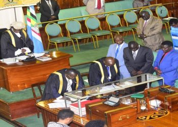 The MPs led by the Speaker, Kadaga observe a moment of silence in honour of the late Kaggwa