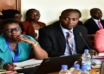 URA Commissioner General Doris Akol (left) and other URA staff appearing before the Committee on Commissions, Statutory Authorities and State Enterprises