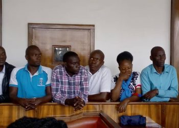 The six FDC supports in dock at Buganda Road Court. Photo by Rachel Agaba.