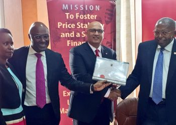 Today, BoU  Governor Prof. Emmanuel  Tumusiime- Mutebile, officially handed over a license to  Absa Uganda  formalizing the name change from the previously held Barclays brand (PHOTO/Courtesy)