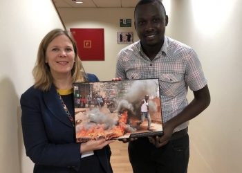 Monitor's Alex Esagala with the deputy head of the European Union (EU) delegation to Uganda, Ms. Anna Merrifield at EU offices in Kampala (PHOTO/Courtesy)