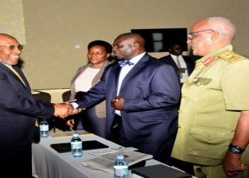 Prime Minister, Dr. Ruhakana Rugunda (left) greats the Deputy Speaker, Jacob Oulanyah, at the launch of the National Mindset Change Transformation Initiative in Kampala on Tuesday, 12 November 2019. Others are: UPDF MP, Pecos Kutesa (right) and State Minister for Gender and Culture, Peace Mutuuzo