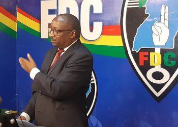 John Kikonyogo, the FDC party deputy spokesperson addressing the press on Monday (PHOTO/Courtesy).