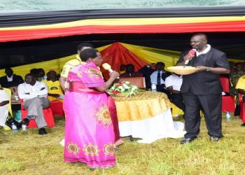 Deputy Speaker Oulanyah (R) conducts the fundraising in Nebbi District (PHOTO/PML Daily).