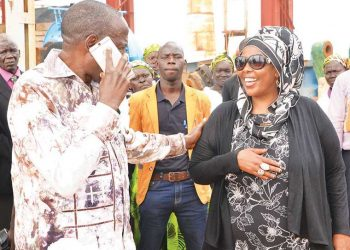 Amina Hersi (R) with Finance minister Matia Kasaija during a tour of the $120 million sugar factory in Atiak recently (PHOTO/Courtesy)