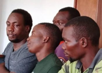 Christopher Aine together with his co accused appearing in Buganda Road Court on Tuesday