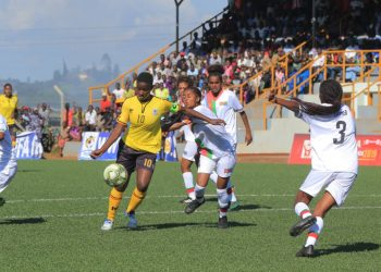 Juliet Nalukenge (10) shrags off an Eritrean defender on Friday afternoon. (PHOTO/FUFA)